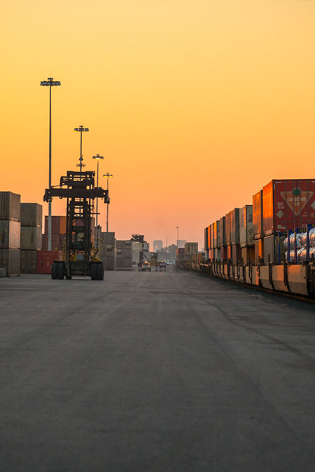 Image of shipping containers and a train at the GTH intermodal yard